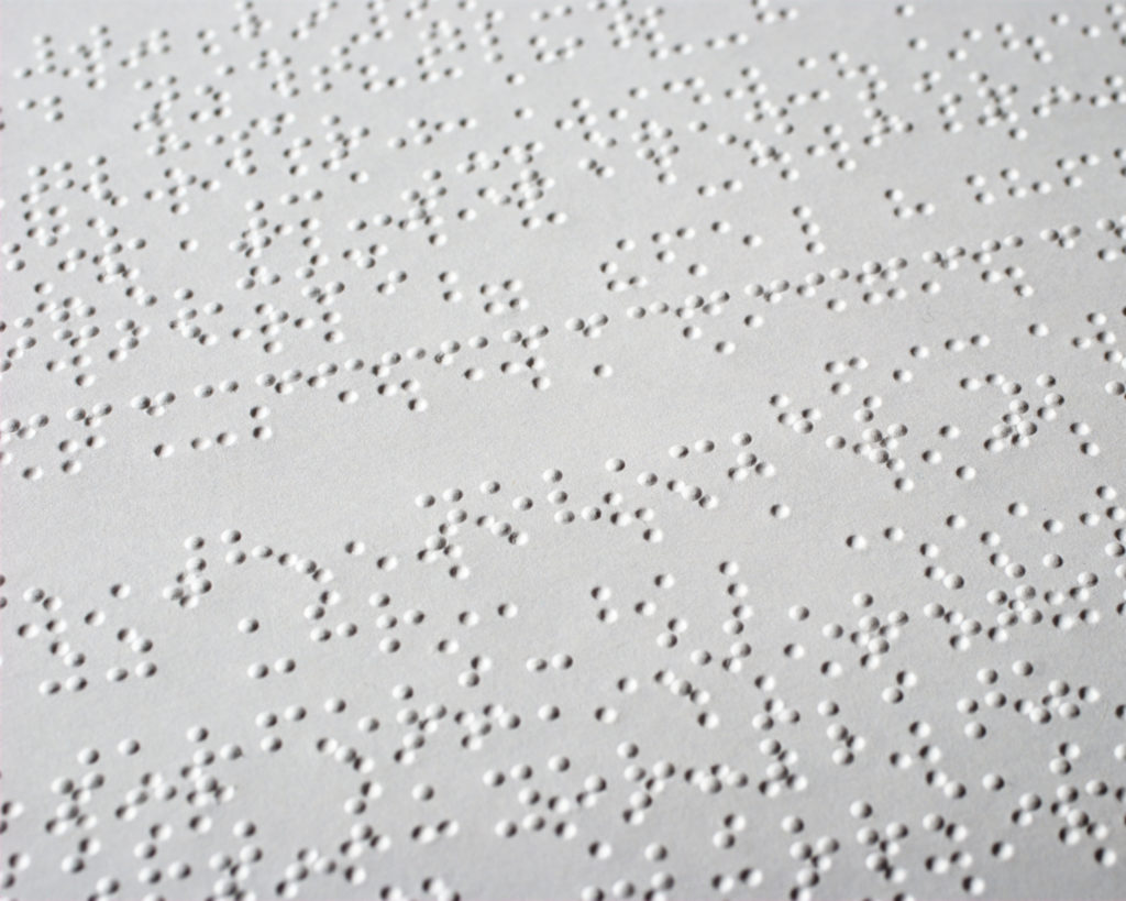 A neutral Braille pattern photo stating that we care for users with any disability.